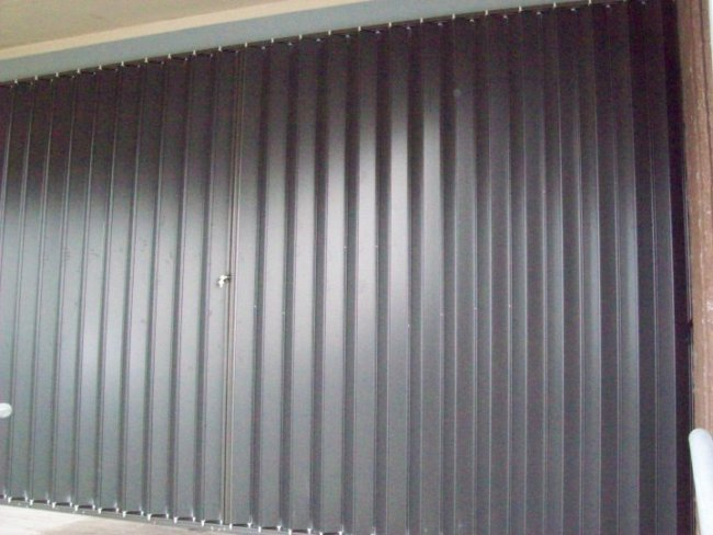 johns-accordion-hurricane-shutters-2