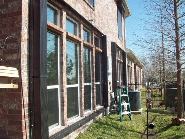 Accordion shutters are perfect for protecting large, easily to reach windows and glass enclosures