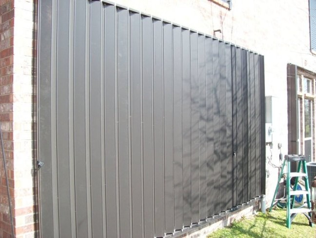Protecting large windows, doors or glass enclusures takes only seconds with accordion hurricane shutters.