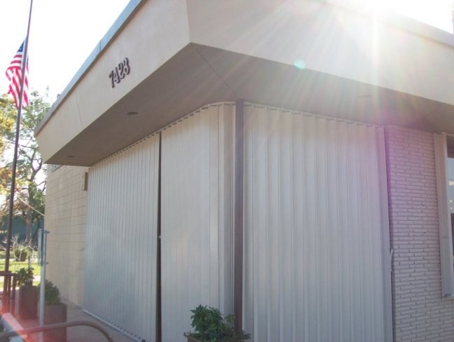 Accordion shutters are excellent for securing commercial buildings from storms and breakins.