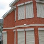 Rolling storm shutters from John's Shutter and Repair deploy in minutes, proctect your home or commercial property from hurricane force winds and secure your property from breakins while you are gone. Call John's Shutter and Repair for a free no-obligatin quote, 409-039-5135.
